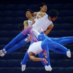 South Korea's Kim Soo-myun rotates above the horizontal bar during men's gymnastics podium training before the 2012 London Olympic Games in London July 25, 2012.   REUTERS/Mike Blake  (BRITAIN - Tags: SPORT OLYMPICS GYMNASTICS)